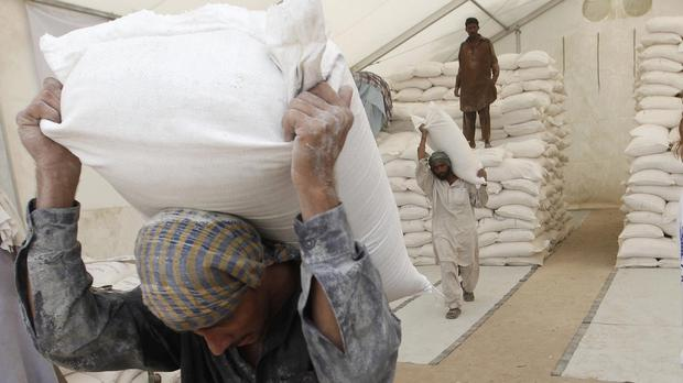 The World Food Programme says the number of refugees receiving its food aid has been cut from 2.1 million to 1.4 million since March