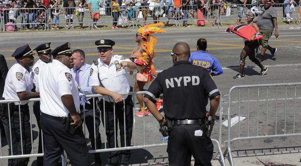 The shooting was one of several violent incidents to take place at the same time as the parade