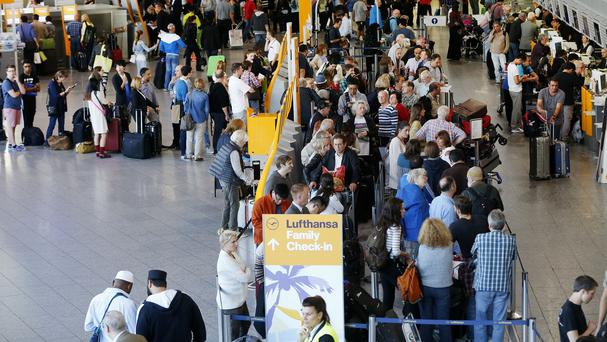 Passengers queue as Lufthansa pilots went on strike in Frankfurt, Germany. (AP)