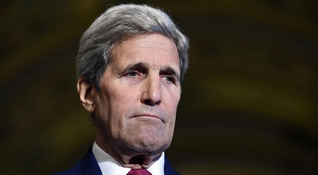 Secretary of State John Kerry says the US is committed to taking more refugees. (AP)