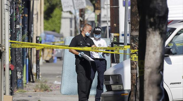 Three children have been found dead inside a car parked outside an elementary school while a man found with them is in critical condition in Los Angeles (AP)