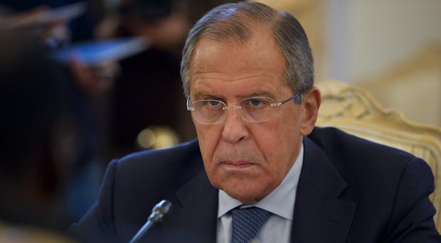 Russia's foreign minister Sergey Lavrov says the planes have been carrying humanitarian aid and military supplies to Syria. (AP)