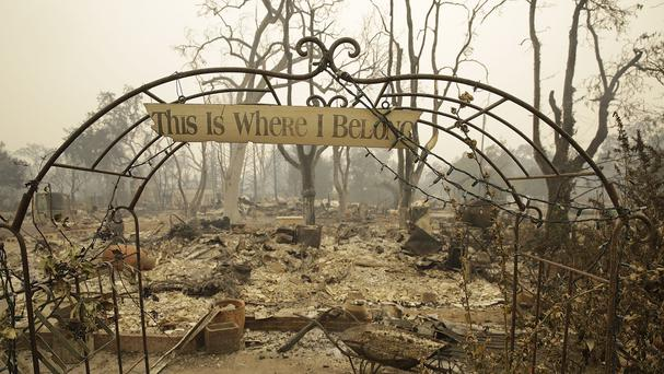A sign hangs above an entryway to a home destroyed by fire in Middletown, California (AP)