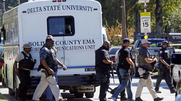 Law enforcement officers at Delta State University during the search for the killer of history professor Ethan Schmidt (AP)