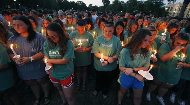 Students, staff and members of the community gather at Delta State University to pay tribute to history professor Ethan Schmidt (AP)