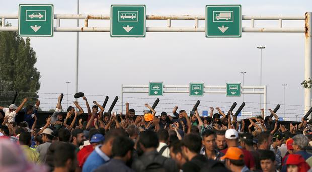 Migrants protest at the Horgos border crossing between Serbia and Hungary (AP)