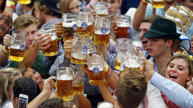 People celebrate the opening of the 182nd Oktoberfest beer festival (AP)