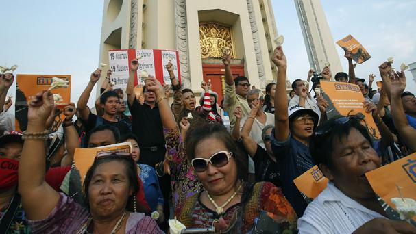 Pro-democracy protesters gather at the Democracy Monument in Bangkok (AP)