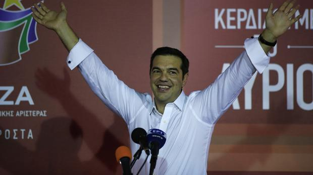 Alexis Tsipras waves to his supporters at Syriza's party's main electoral base in Athens (AP)