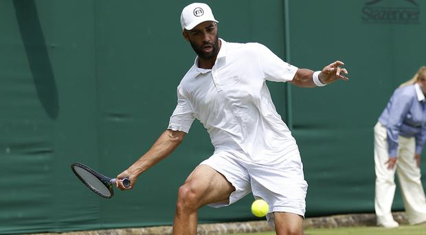 James Blake in action at Wimbledon in 2013