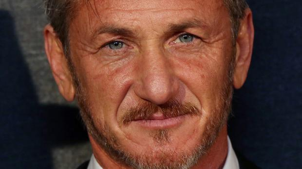 Sean Penn, pictured, claims Empire co-creator Lee Daniels has damaged his reputation with comments that suggested Penn was a domestic abuser (Invision/AP)