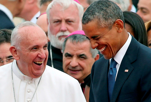 President Barack Obama and Pope Francis share a joke