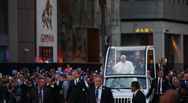 Pope Francis arrives on Fifth Avenue on his way to St Patrick's Cathedral in New York (The New York Times/AP)