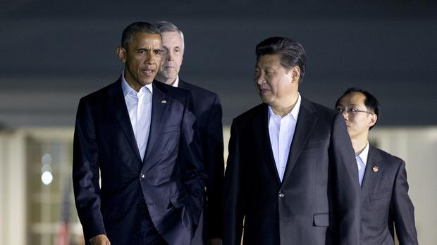 Barack Obama and Xi Jinping walk from the West Wing of the White House (AP)