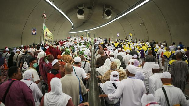 Muslim pilgrims walk in a tunnel on their way to cast stones at Jamarrat pillars (AP)