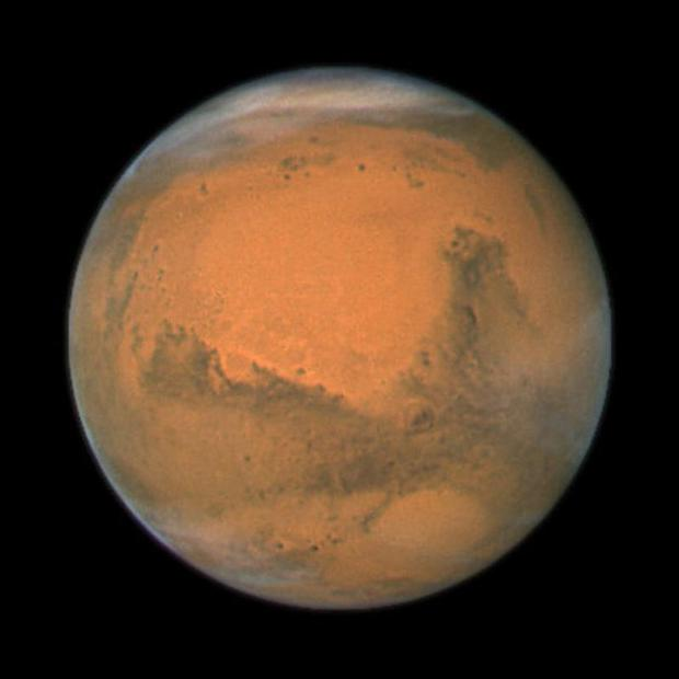 Experts believe flowing liquid water is almost certainly responsible for mysterious features on Mars that change with the seasons