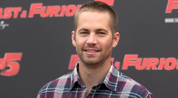 Paul Walker was on a break from filming Fast & Furious 7 when he was killed (AP)