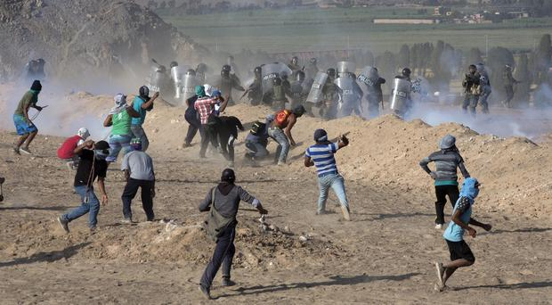 There have been many clashes in Peru between police and farmers opposed to mining projects (AP)