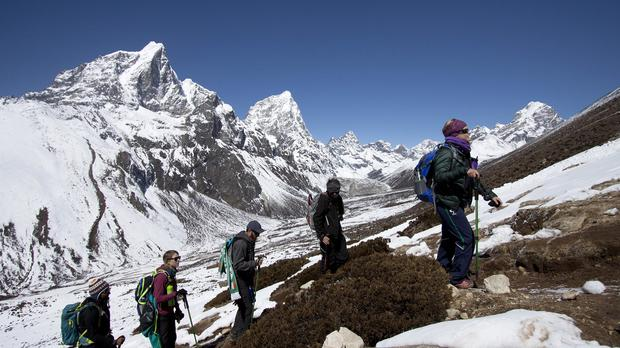 Nepal is considering placing age and fitness limits for people who want to climb Everest. (AP)