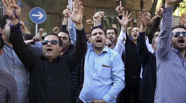 Iranian protesters in front of the Saudi Arabian Embassy in Tehran. (AP)