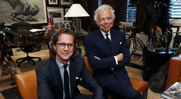 Designer Ralph Lauren, right, poses in his office with Stefan Larsson (AP)