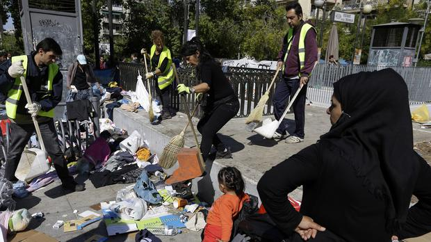 Workers clear Victoria square in Athens, where hundreds of migrants and refugees have been staying temporarily. (AP)