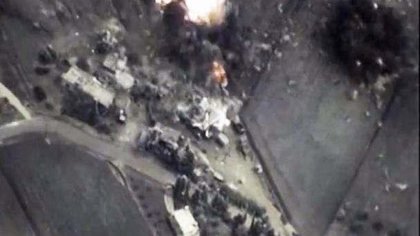 Footage from the Russian defence ministry official web site shows a bomb explosion in Syria (/ Russian defence ministry/AP)