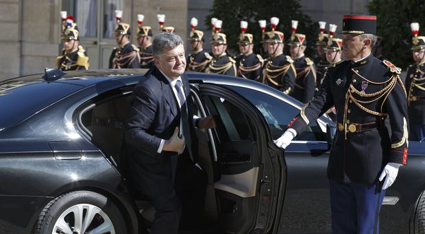 Ukrainian President Petro Poroshenko arrives at the Elysee Palace in Paris. (AP)