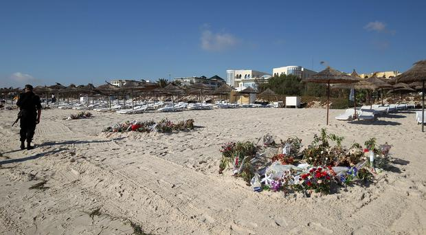 Flowers on the beach at Sousse, Tunisia, where 38 people were shot dead in a terror attack in June