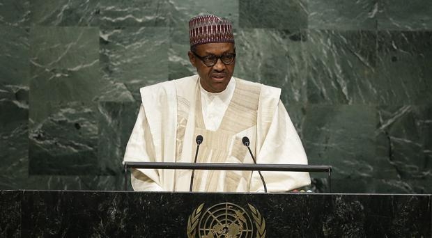 Muhammadu Buhari, pictured speaking during the 70th session of the UN General Assembly, claimed that Boko Haram were on the run (AP)