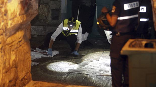 Israeli forensic officers at the scene of an attack in Jerusalem's Old City (AP)