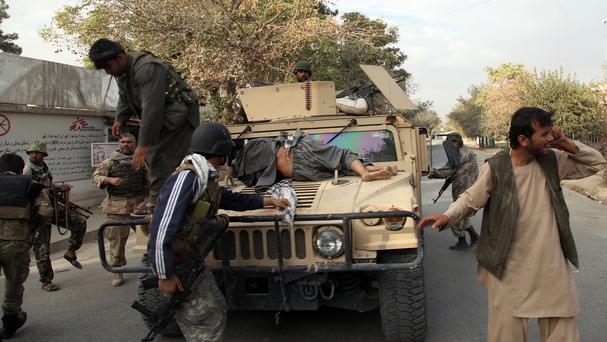 Afghan security forces take a wounded civilian man to hospital in Kunduz (AP)