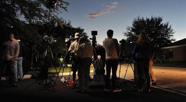 Television crews wait for an update outside the Seafarers International Union hall in Jacksonville, Florida (Bruce Lipsky/The Florida Times-Union via AP)