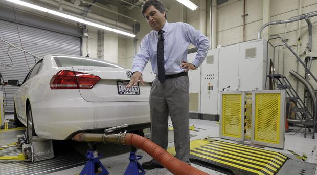 California Air Resources Board spokesman John Swanton explains how a 2013 Volkswagen Passat diesel model is tested for emissions (AP)