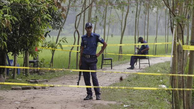 Bangladeshi security officers at the site where Japanese citizen Kunio Hoshi was shot dead (AP)