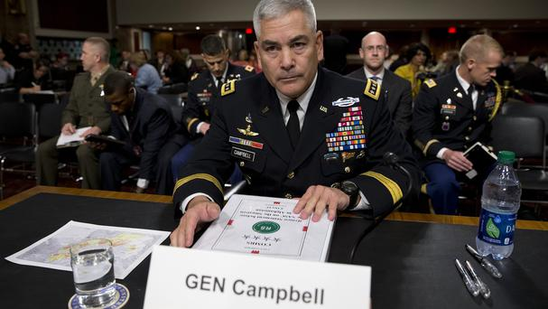 General John Campbell takes his seat on Capitol Hill in Washington prior to giving evidence before the Senate armed services committee (AP)