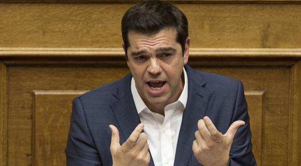 Prime minister Alexis Tsipras says he can lead Greece out of its financial crisis by 2019 (AP)