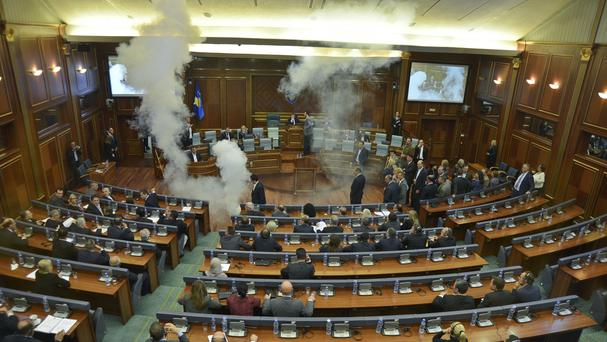 Opposition politicians in Kosovo use tear gas and whistles in parliament in the capital Pristina (AP)