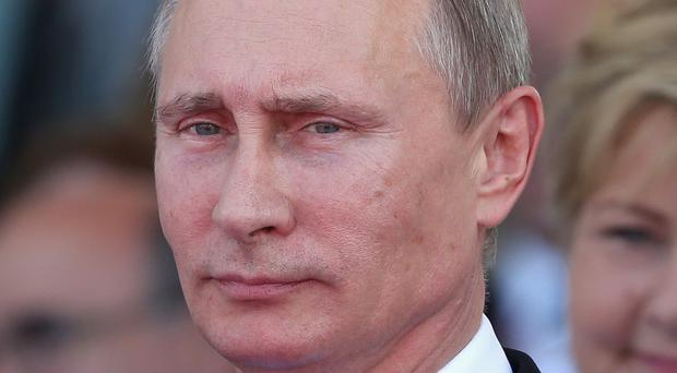 Russian President Vladimir Putin has stepped up the Russian military campaign in Syria (PA)