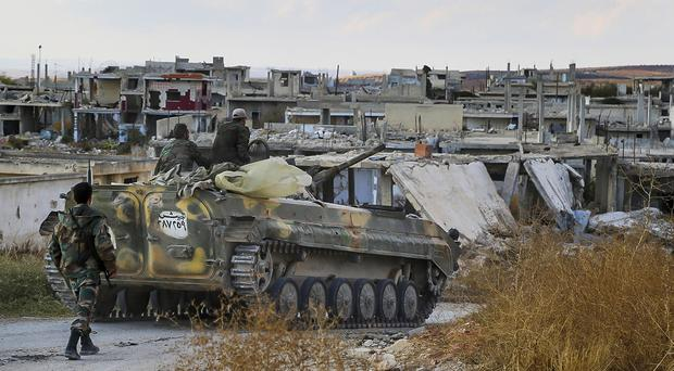 The Syrian army's offensive has been aided by Russian air strikes (Komsomolskaya Pravda/AP)