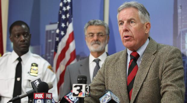 Cuyahoga County prosecutor Timothy McGinty, foreground, speaks during a news conference at police headquarters in Cleveland (The Plain Dealer/AP)