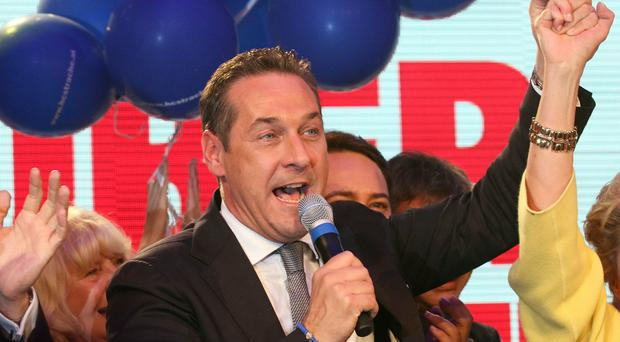 Heinz Christian Strache from the right-wing Freedom Party celebrates his election victory in Vienna, but the Socialists held on to city hall (AP)