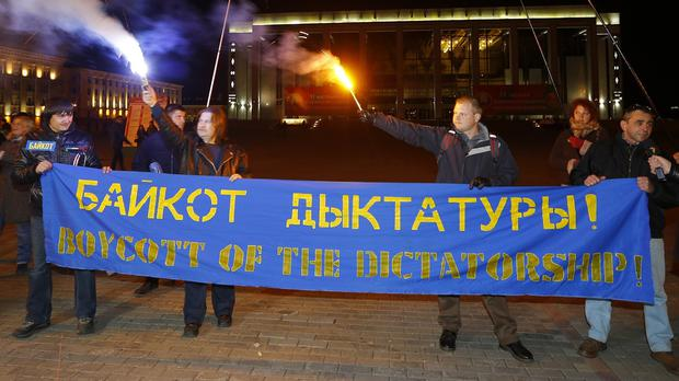Opposition activists rally in the city centre after presidential elections in Minsk, Belarus (AP)