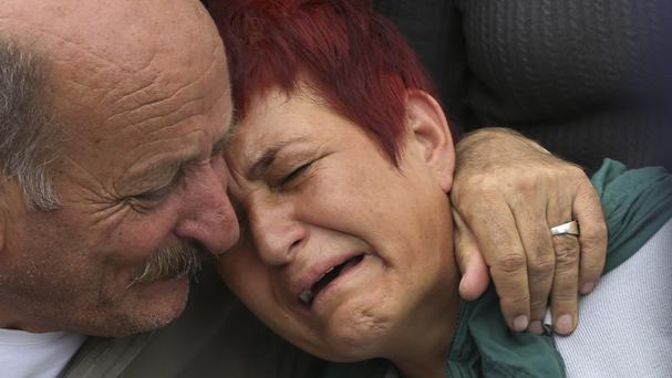 Relatives cry during the funeral of Korkmaz Tedik, 25, killed in Saturday's bombing attacks (AP)