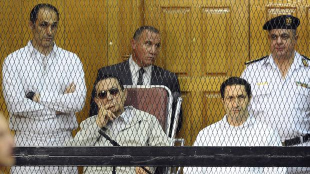 Former Egyptian president Hosni Mubarak and his two sons, Gamal Mubarak, left, and Alaa Mubarak (AP)
