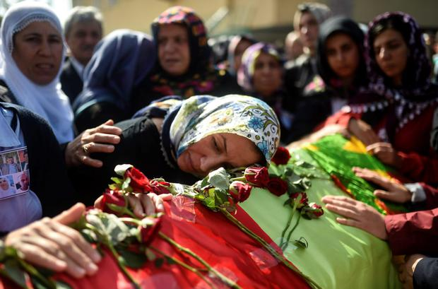 Relatives mourn the death of one of the victims of the bombing in the Turkish capital of Ankara last Saturday