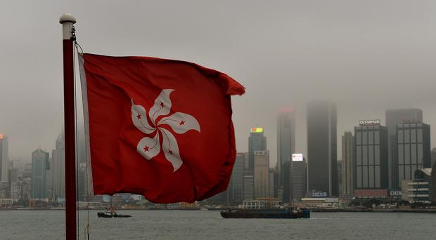 Seven Hong Kong police officers have been charged