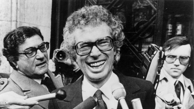 Ken Taylor meeting journalists outside the Canadian embassy in Paris in 1980. (AP)