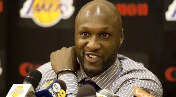 Lamar Odom was found unconscious with white and reddish substances coming from his nose and mouth. (AP)