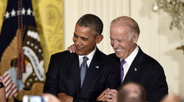 Joe Biden (right) may yet enter the race to succeed Barack Obama